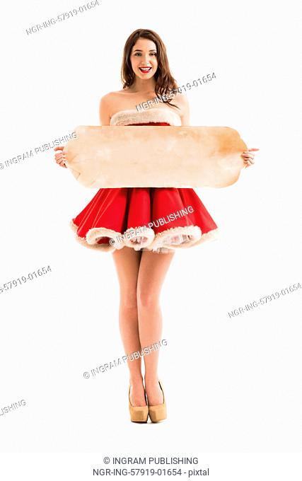 Christmas woman hold big old roll. Santa dress. Isolated smiling girl