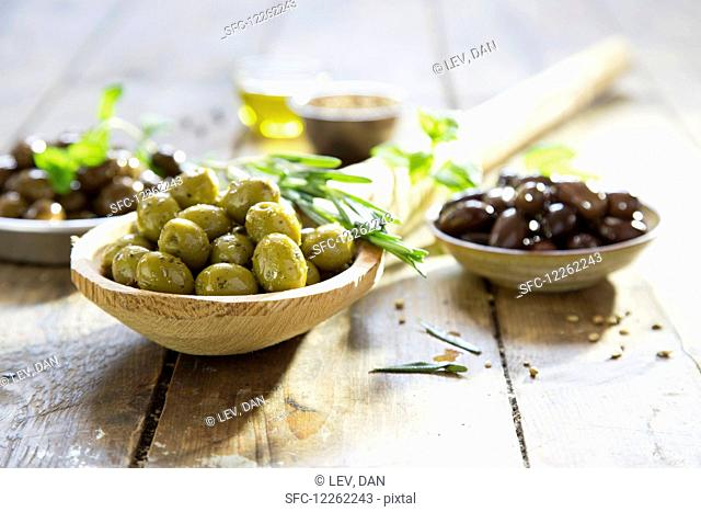 Various marinated olives with herbs