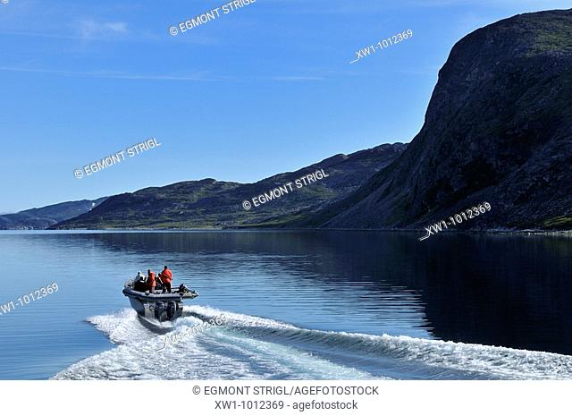 motorboat cruising through Saglek Fjord, Torngat Mountains National Park, Newfoundland and Labrador, Canada