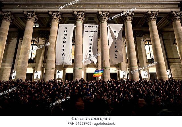 Participants of a demonstration against right-wing extremism, xenophobia, and the anti-Islam movement 'Pegida' stand in front of the Bavarian State Opera in...
