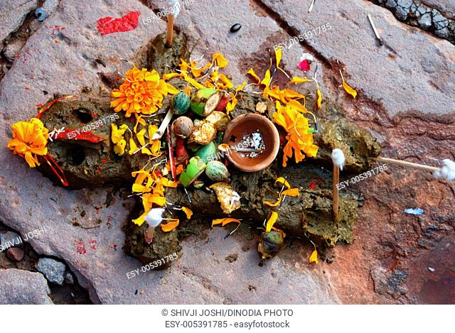 Govardhan made of cowdung in front of house being worshipped on occasion of diwali , Jodhpur , Rajasthan , India