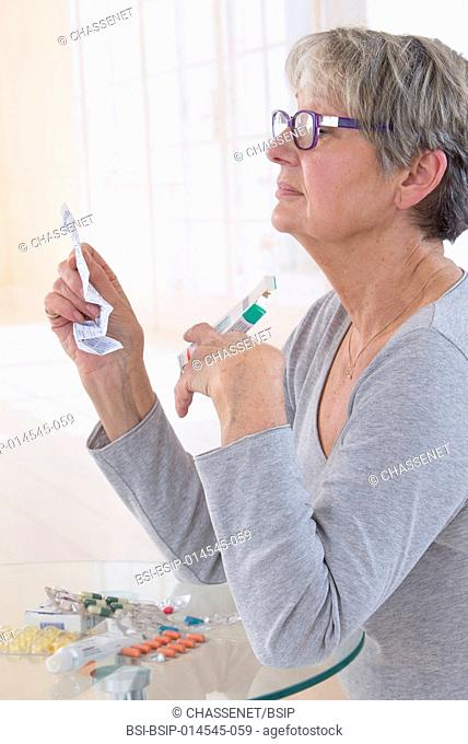 A woman reading a dosage sheet