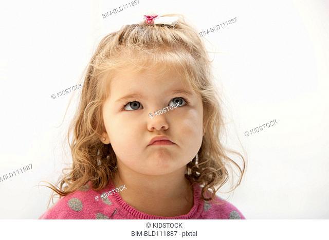 Caucasian toddler pouting