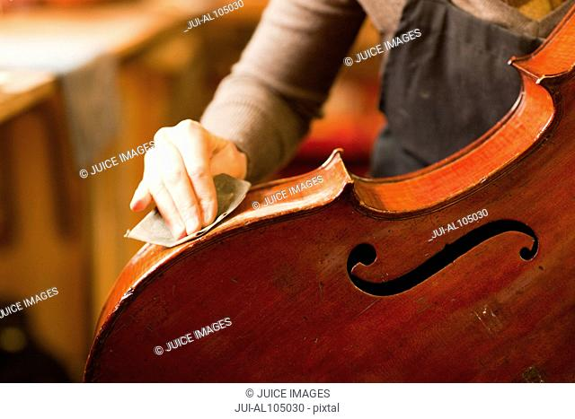 Violin maker restoring a cello