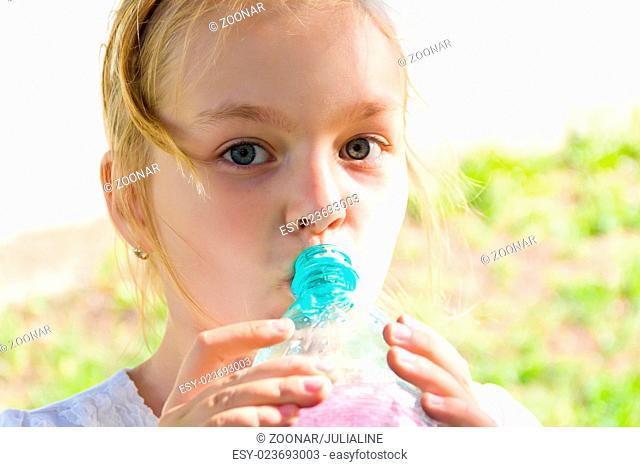 Cute girl drinking water
