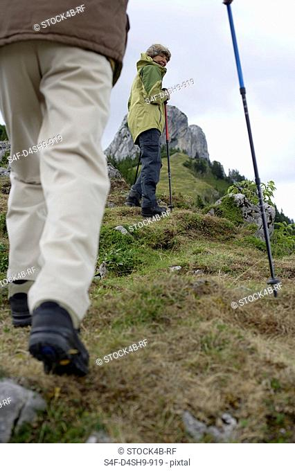 Senior adult couple hiking in the mountains part of, low angle view
