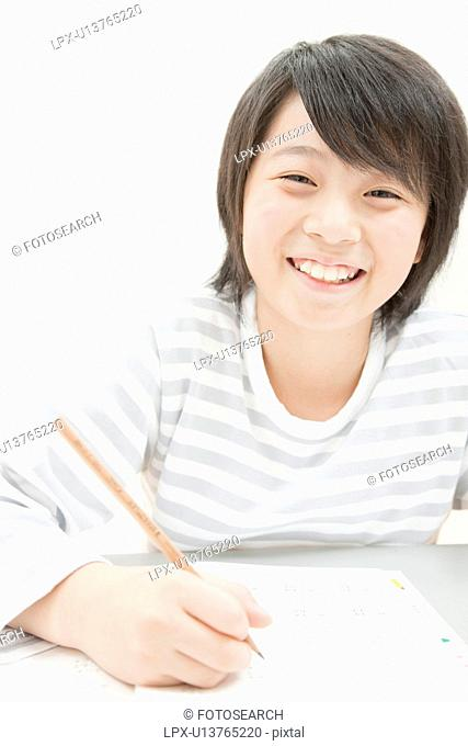 A Boy Studying at Desk