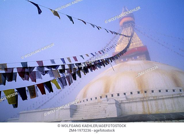 NEPAL, KATHMANDU, BOUDHNATH, TIBETAN STUPA (TEMPLE) IN FOG, PRAYER FLAGS