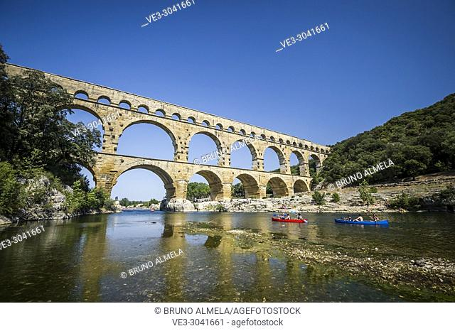 Kayaking at Gard River near roman aqueduct Pont du Gard (department of Gard, region of Occitanie, France)