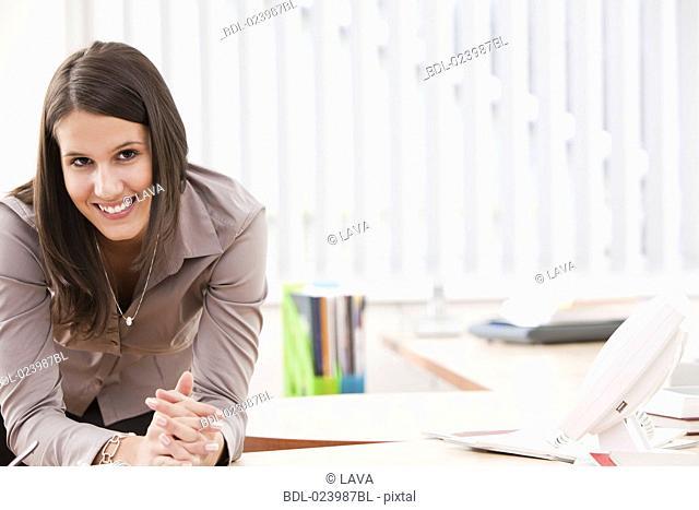 portrait of young busineswoman at desk
