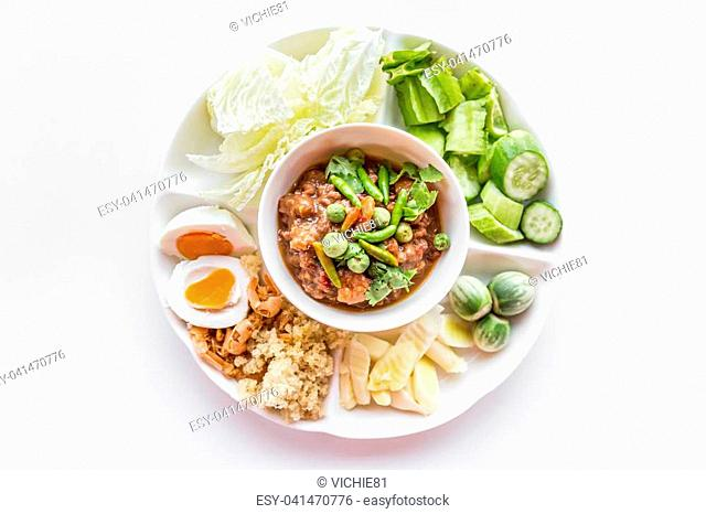 Thai chili paste with fresh vegetables on white background