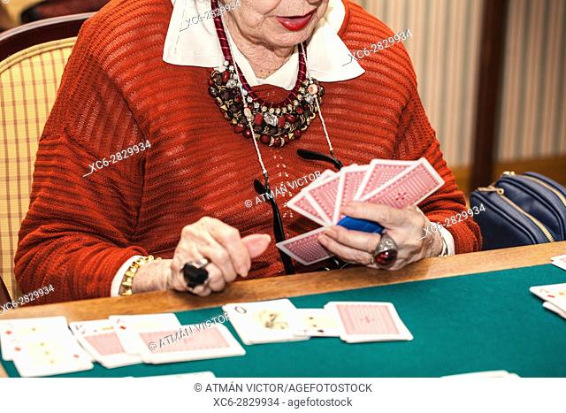 old woman playing canasta game