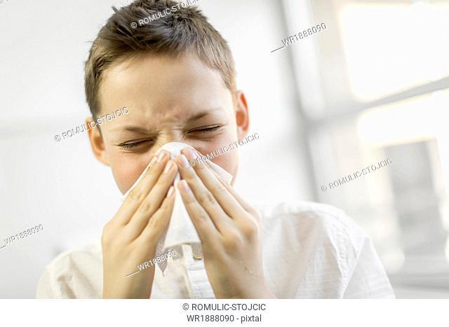 Sick boy blowing his nose, Osijek, Croatia