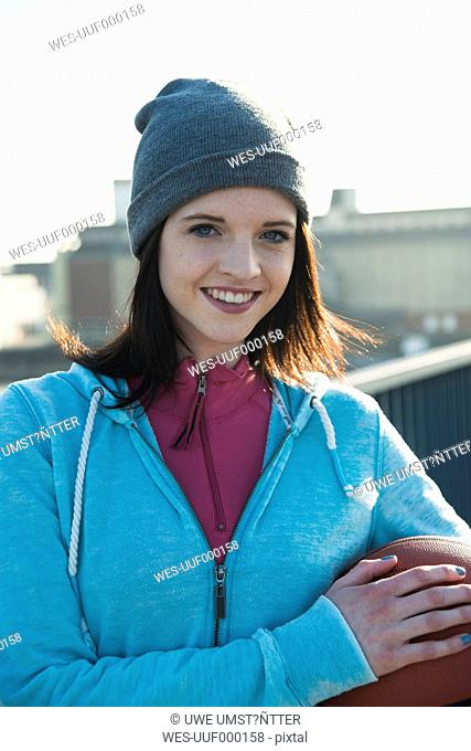 Portrait of smiling young sportswoman