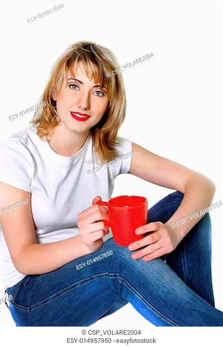 studio shot of attractive young girl with red cup over white