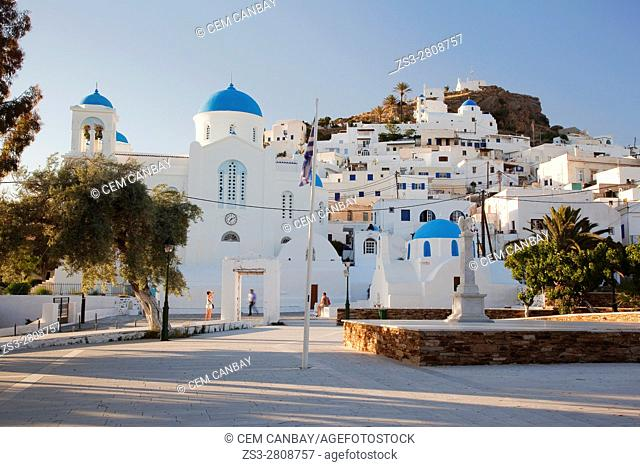Tourists taking photos in front of the blue domed churches in the old town Chora, Ios, Cyclades Islands, Greek Islands, Greece, Europe