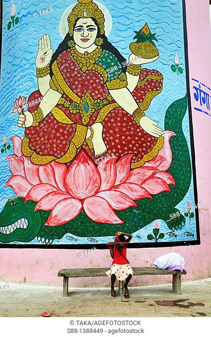 Wall Hindu God painting at the ghat by the Ganges river