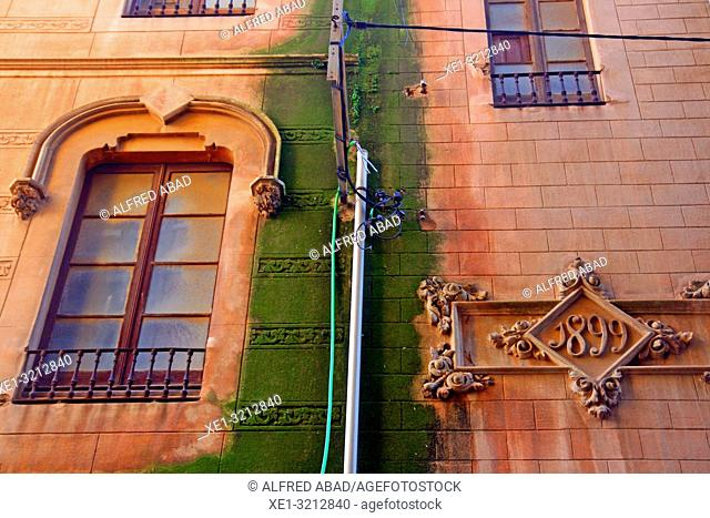 windows and downpipe in 1899 building, Sant Feliu de Guixols, Girona, Catalonia, Spain