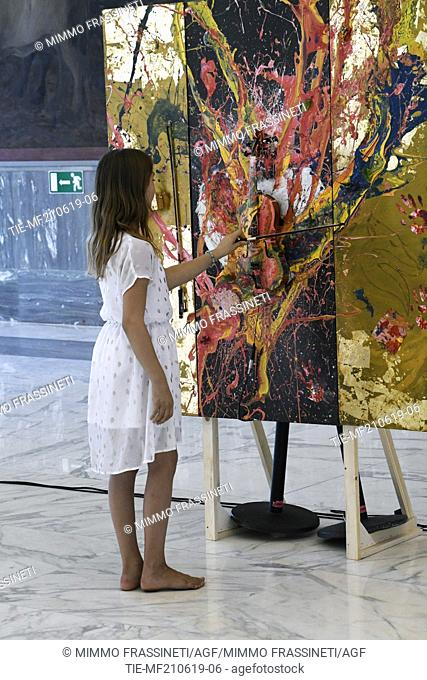 Aelita Andre, Australian young painter (12 years old ) during an art performance at the Museum of Civiltà in Rome ,ITALY-20-06-2019