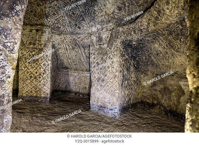 ancient underground burial room with carved columns in in Tierradentro National archeological park. Department of Cauca, Colombia