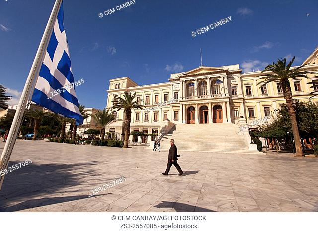 Greek flag in front of the Neo Classic City Hall of Ermoupolis in Miaoulis Square, Ermoupolis, Syros, Cyclades Islands, Greek Islands, Greece, Europe