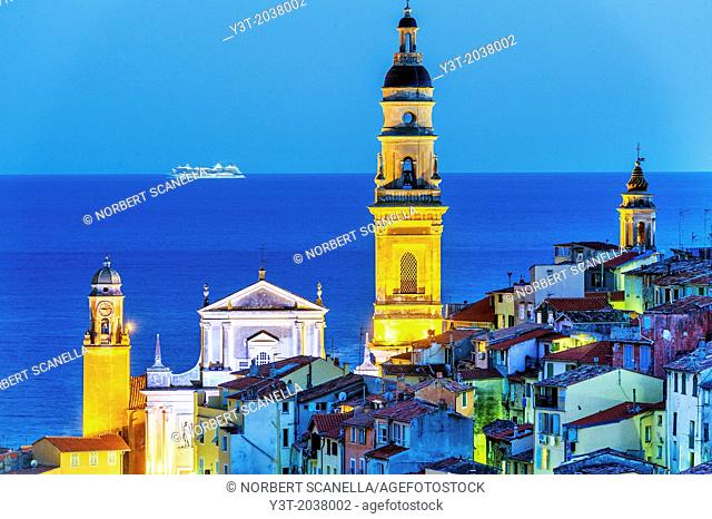 Europe, France, Alpes-Maritimes, Menton. The old town, and the Basilica of Saint Michel at night