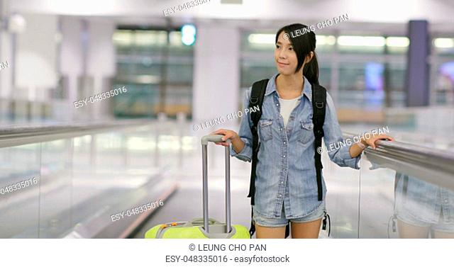 Woman go travel and carry with luggage in the airport