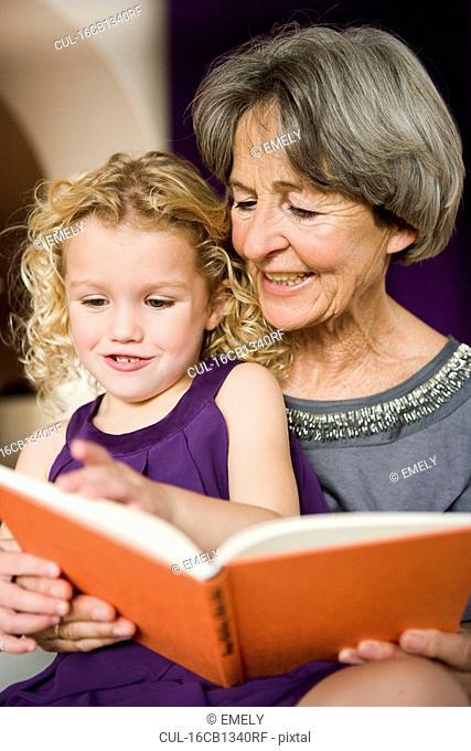 grandchild and grandma reading book