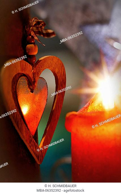 Red burning candle with decoration heart