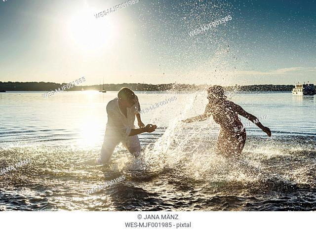 Couple squirting each other with water