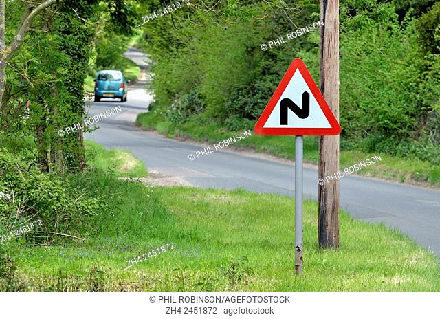 'Double Bend' warning roadsign on a narrow country road in Norfolk, England
