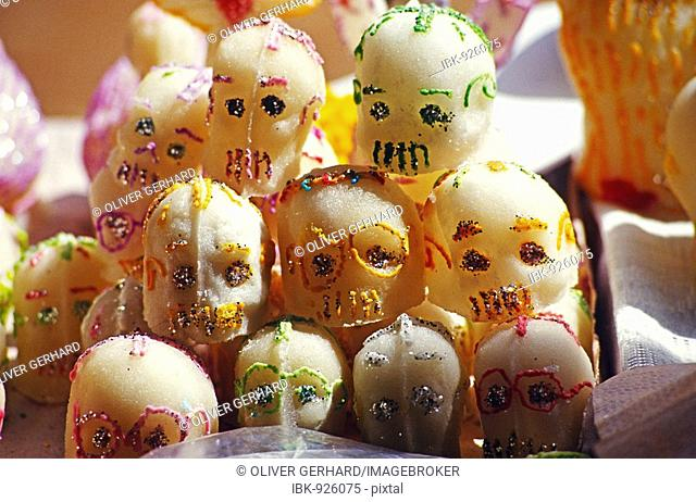 Marzipan skull good luck charms at the Day of the Dead Festival during All Saints' Day or All Hallows in Patzcuaro, Michoacan, Mexico, North America