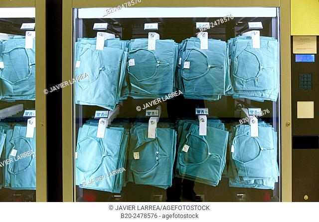 Scrubs on display in vending machine, Hospital Donostia, San Sebastian, Basque Country, Spain