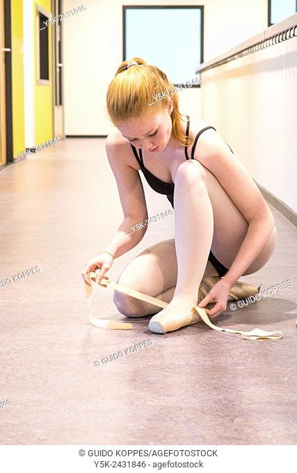 Den Bosch, 's-Hertogenbosch, Netherlands. Teenage schoolgirl practising classica ballet at a local balletstudio
