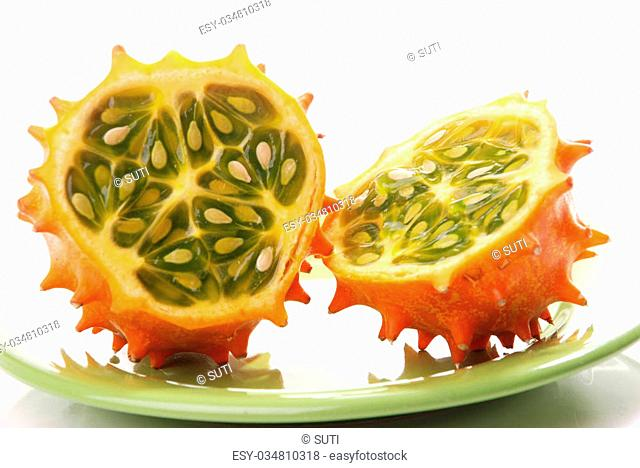 Kiwano or African horned melon . Also known as hedged gourd, African Horned Cucumber, English tomato