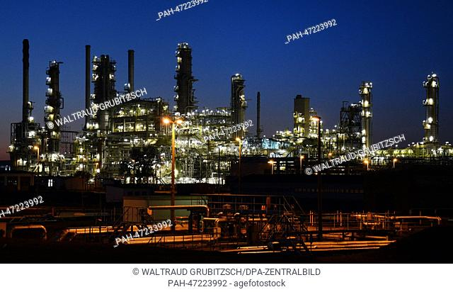 A part of the facilities of the 'Total' oil refinery in Leuna (SA) is silhouetted against the evening sky illuminated by the setting sun in Spergau, Germany