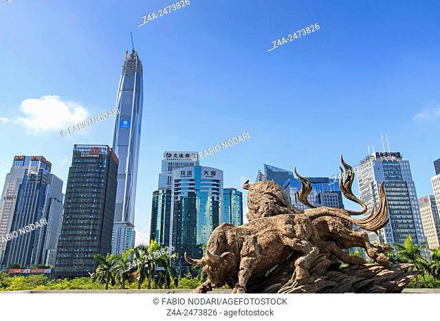Shenzhen, China - August 19,2015: Stock market building in Shenzhen, one of the three stock markets in China, with the copper bull statue on foreground
