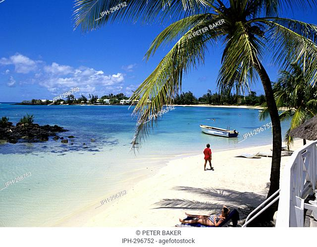 Idyllic Merville Beach on Grand Baie, a popular tourist resort in the Pamplemousses district on the island of Mauritius