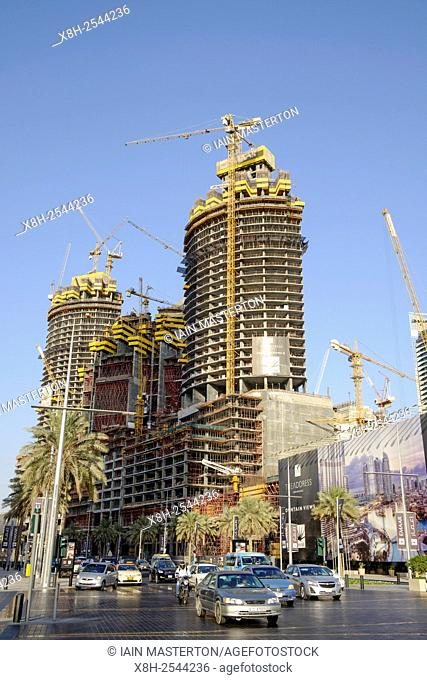 Three high-rise apartment towers under construction in Downtown Dubai district in United Arab Emirates