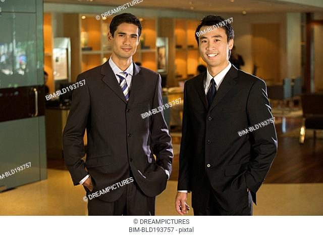 Chinese businessmen standing in bar