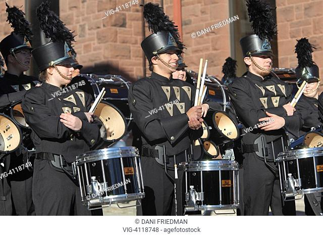Members of a marching band stand ready to perform during the Thanksgiving Day Parade in Waterloo, Ontario, Canada. Thanksgiving Day is a national holiday which...