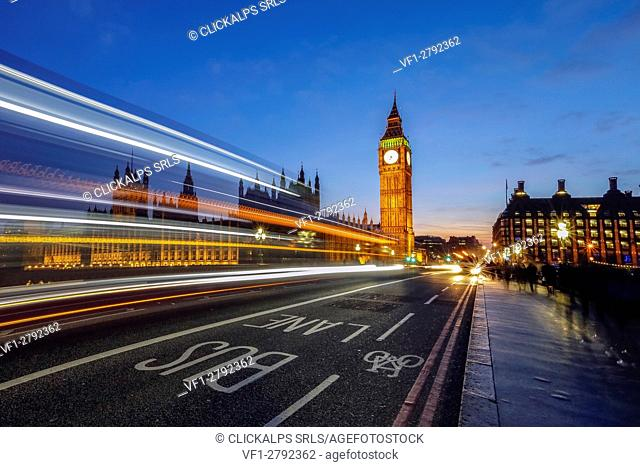 Doubledeckerbus runs towards Big Ben also called Elizabeth Tower, located north end of the Palace of Westminster in London United Kingdom Europe