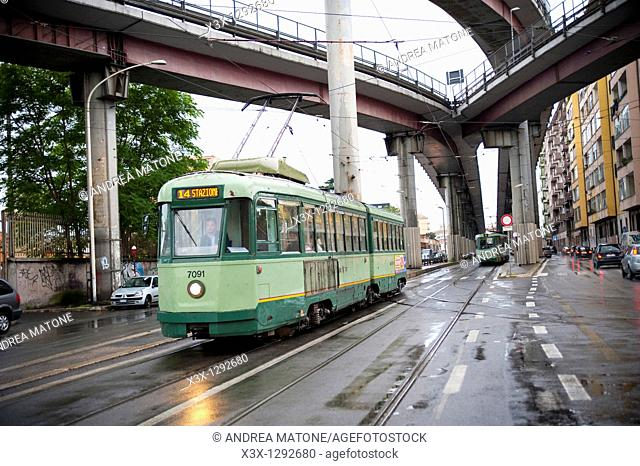 Via Prenestina with a trolley car underneath highway Tangenziale Est in Rome Italy