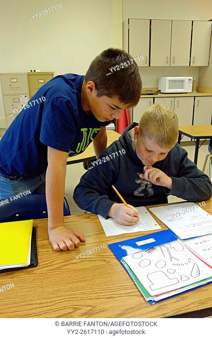 6th Grade Boys Working on Math Problem, Wellsville, New York, United States