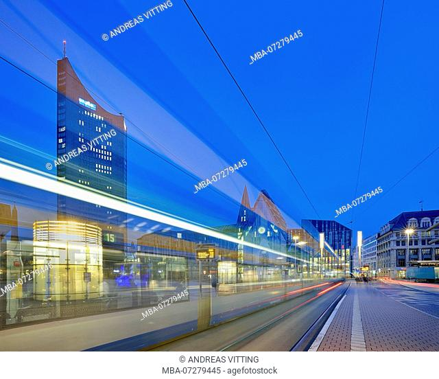 Germany, Saxony, Leipzig, The Augustusplatz with 'City Hochhaus' as well as Augusteum and Paulinum University, night shot with light traces of the tram
