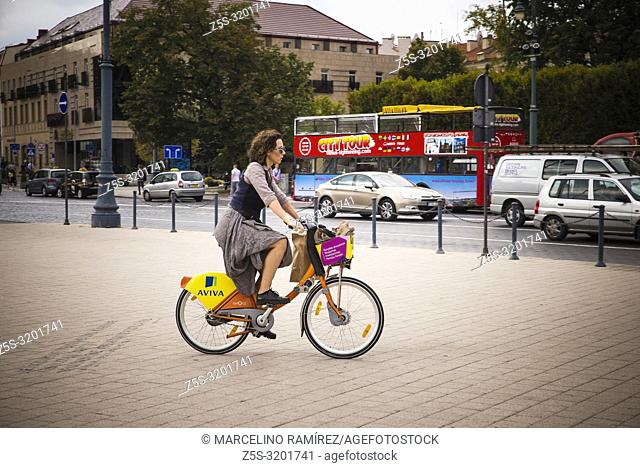 Woman on bicycle next to the cathedral square. Vilnius, Vilnius County, Lithuania, Baltic states, Europe