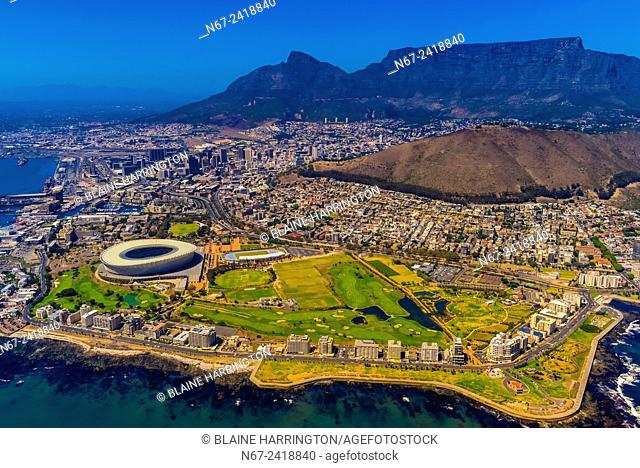 Aerial view of coastline of Cape Town with Signal Hill and Table Mountain in background, South Africa