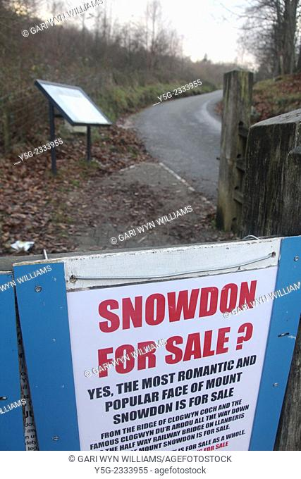 Llanberis, Wales, UK - 29th December, 2014. Snowdon for sale signs at the start of the popular mountain public footpath in Llanberis, North Wales, Great Britain