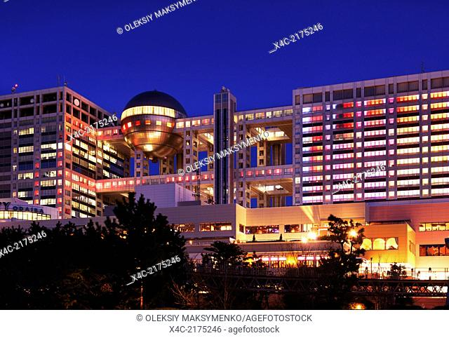 Fuji Television Headquaters building with colorful illumination at night in Odaiba, Tokyo, Japan