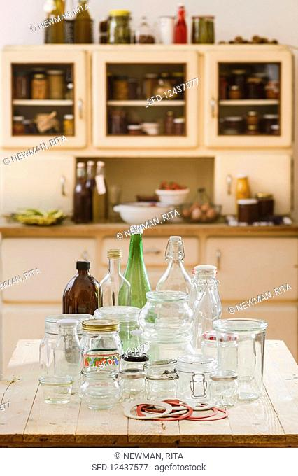 Empty bottles and glasses on a kitchen table